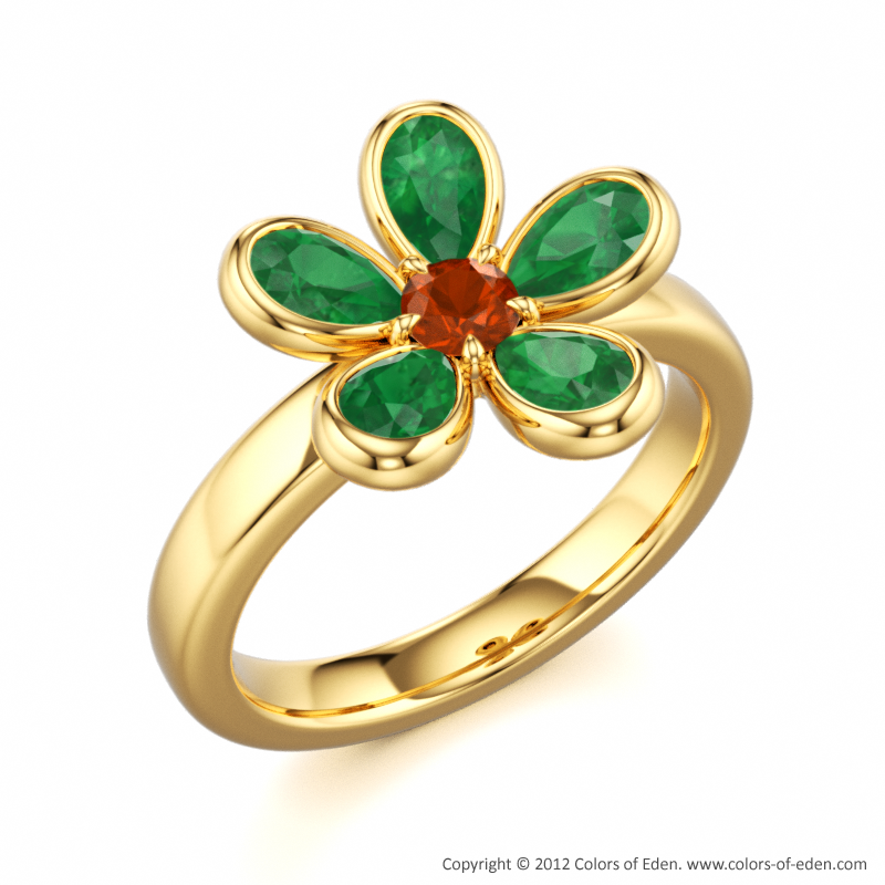 The floral charm of this ring can be enhanced by choosing different colored stones. Its elements form a magnificent flower that never fades. Presenting My Little Darling ring: Pear shaped Emeralds + Round Fire Opal + 18k Yellow Gold.