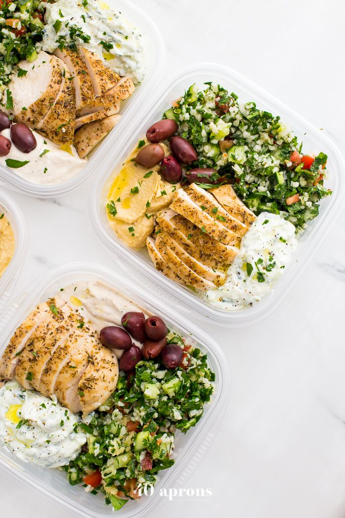 This Greek healthy meal prep recipe is epic: cauliflower rice tabbouleh, tender chicken breasts, hummus or baba ganoush, olives, & a rich garlicky tzatziki.