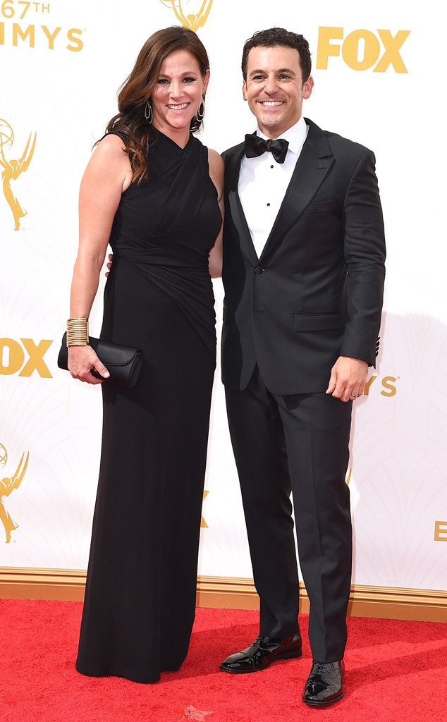 Jennifer Lynn Stone & Fred Savage from 2015 Emmys: Red Carpet Couples  The Emmys presenter and his wife coordinate all black ensembles.PHOTOS: 2015 Emmys Red Carpet Arrivals