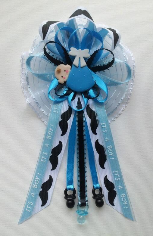 Perfect Mustache Theme Mommy Baby Shower Corsage With Baby In Blue Swaddle