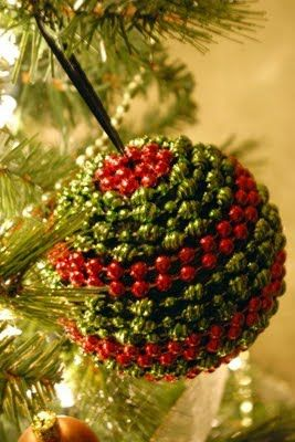 styrofoam balls, beads, christmas ornaments:) must make this. I have a ton of those cheap plastic mardi grad type beads. There must be some red and greens in there to make this with : )
