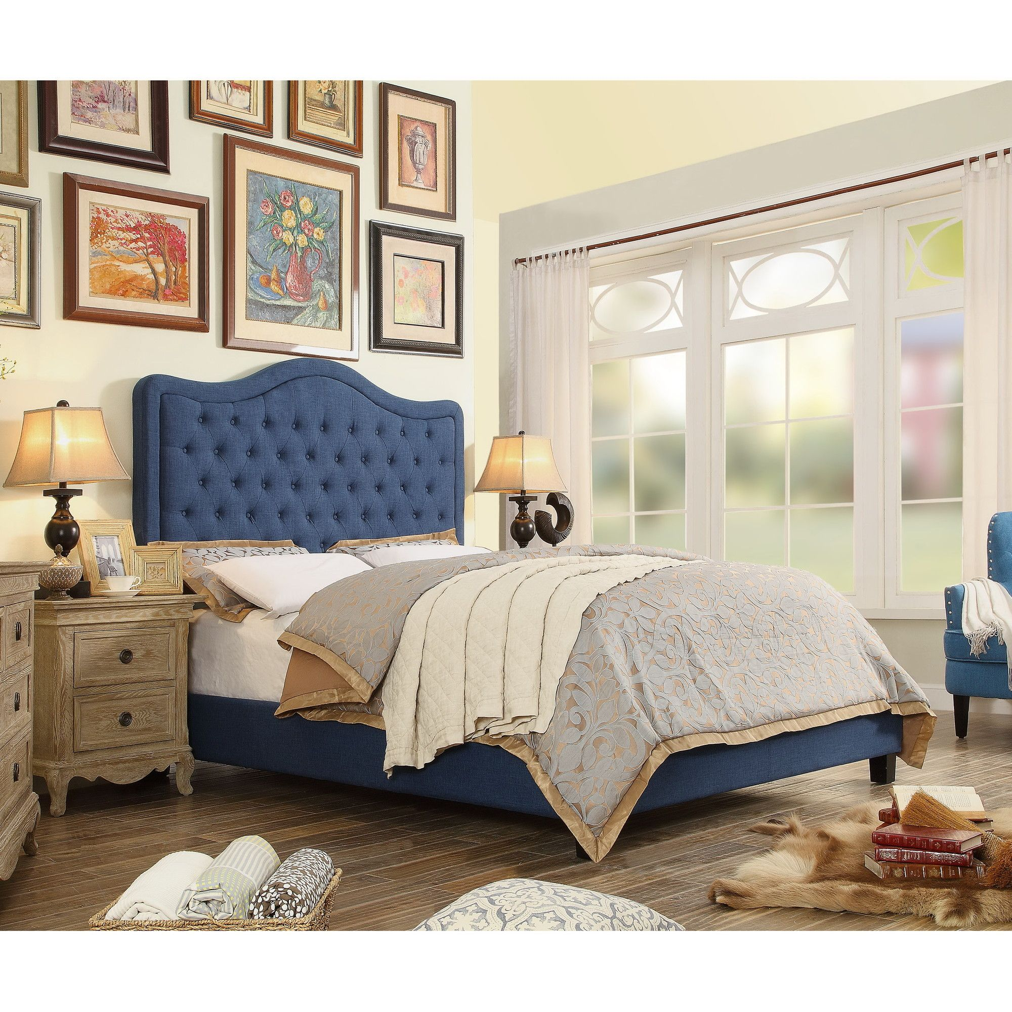 This upholstered panel bed collection is decorative with