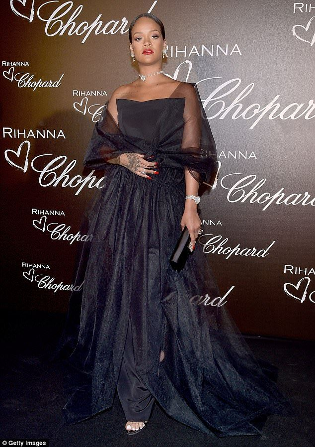 902f4045cb Glamour  Rihanna exuded old-school Hollywood glamour in a black tulle gown  as she attended.