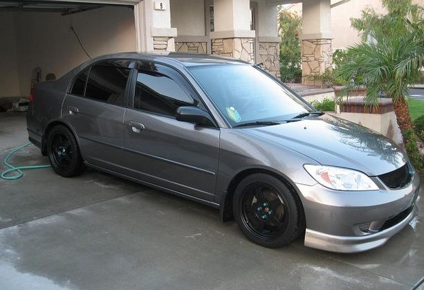 In The Sedan, The Highlights And Glow With Amber Light View Specs And  Features For The 2004 Honda Civic.
