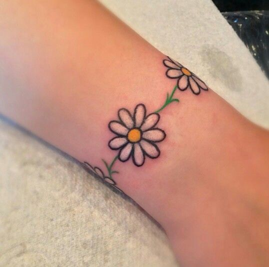 61 Small Daisy Tattoos Ideas With Meaning In 2020 Daisy Chain Tattoo Daisy Tattoo Anklet Tattoos