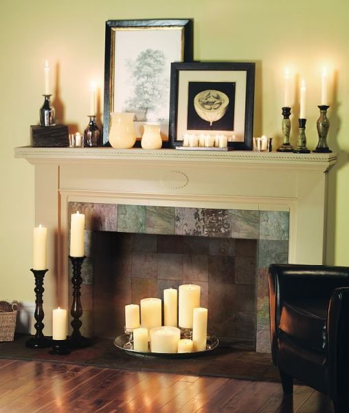 Decorating your fireplace with candles is great for false-fireplaces and during the summer months. Use Candle Impressions flameless pillar candles and benefit from the timer option and safety of going flameless #candleimpressions #flamelesscandles