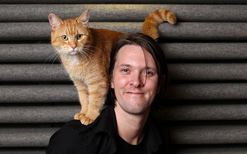 A street cat named Bob, with owner James Bowen, a former homeless drug addict, woh credits the cat for helping him turn his life around