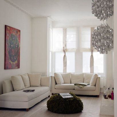 A Single Large Painting, A Heavily Textured Pouf And A Striking Light  Fitting Bring Texture, Warmth And Interest To An Otherwise Minimal Sitting  Room. Awesome Ideas