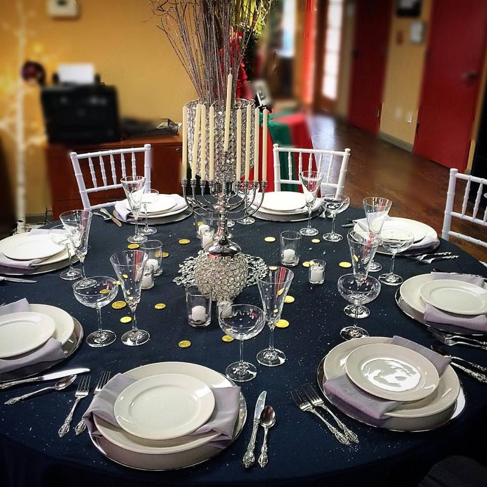 Happy Hanukkah!✡ #midnightblue #silverbengaline #bubblyglasses #rimmedplates #traditionalflatware #crystal #chiavarichairs #menorah #goldcoins #hanukkah #partyrentals #sf #bayarea #holidays #events #big4party