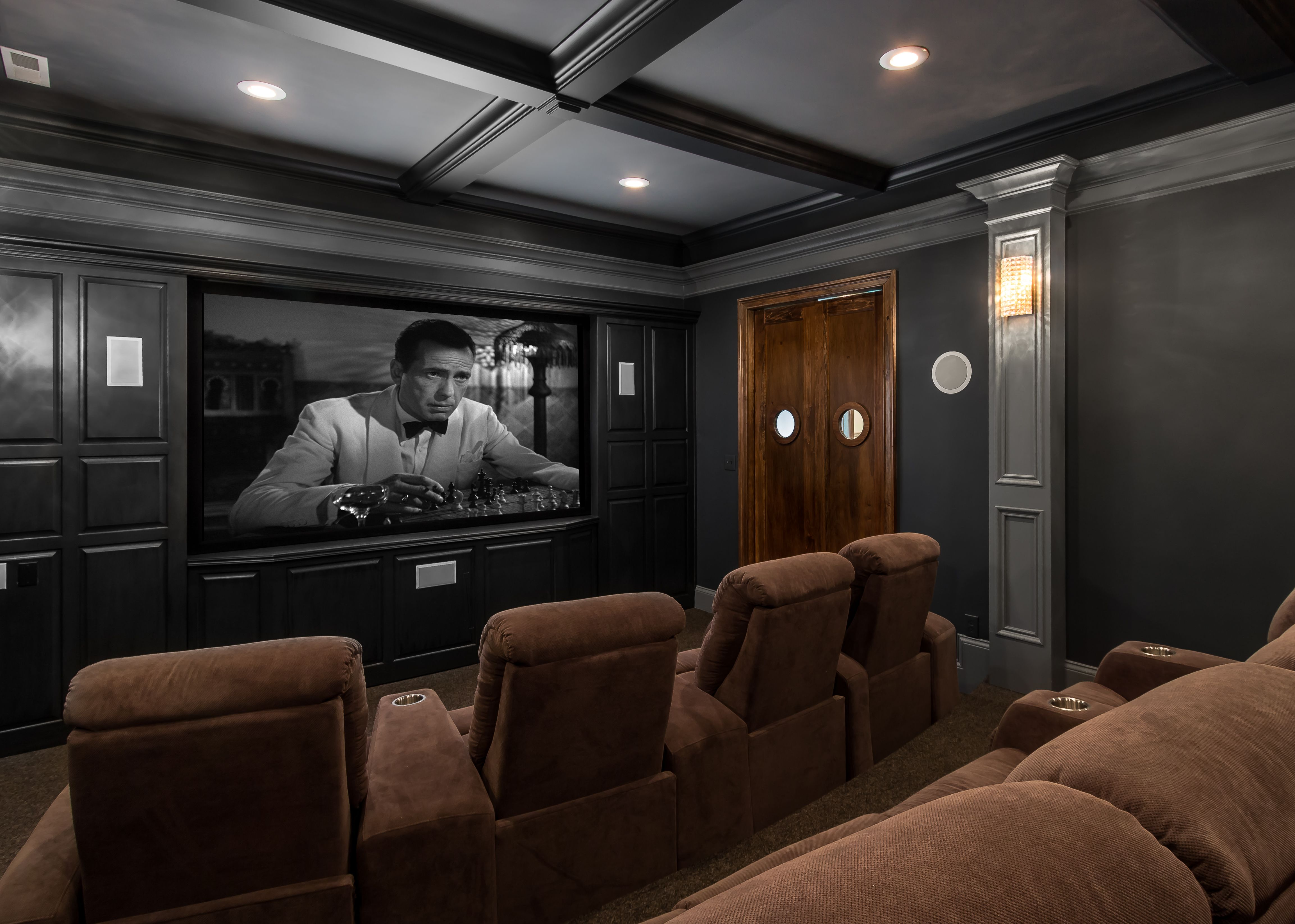 Media Room With Elevated Theater Seating And Authentic Double
