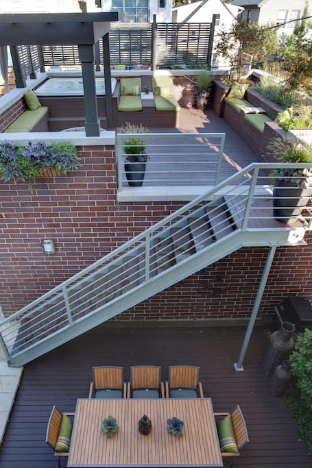 The Garage Roof Deck Has A Fire Pit Seating For 15 And A Hot Tub Exterior Stairs Rooftop Design Rooftop Patio