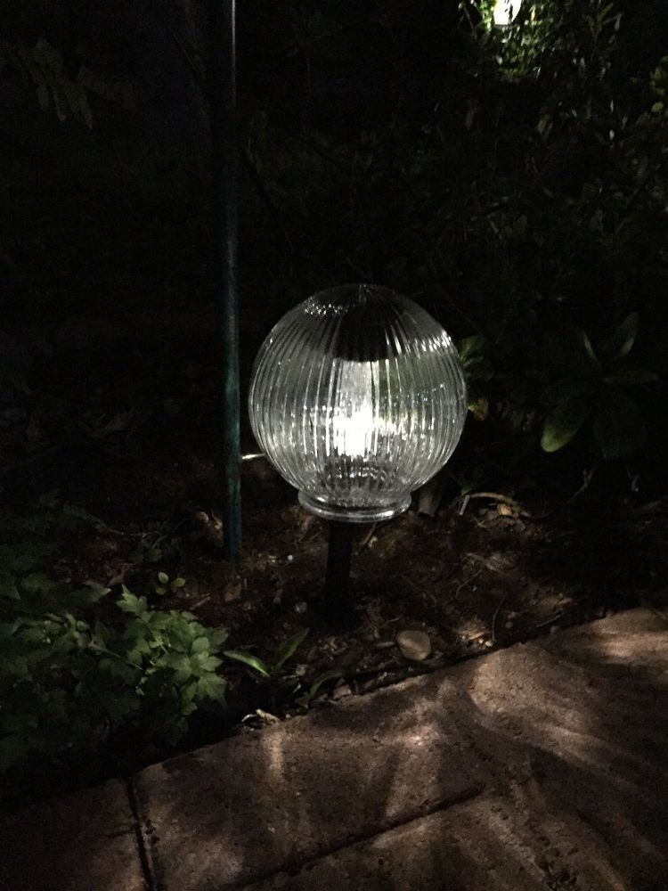 Garden Solar Power Decoration, Lighting, Using A Solar Light With A Glass  Interior Light Cover Over It
