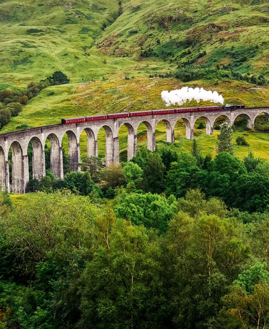 Steam train on a famous Glenfinnan viaduct, Scotland | 19 Reasons Why Scotland Must Be on Your Bucket List.