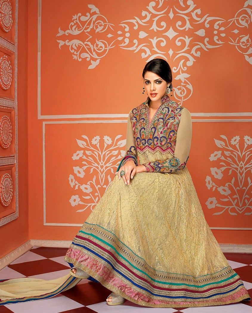 Graceful beige embroidery anarkali suit   1. Beige embroidered georgette net suit2. Comes with matching bottom and dupatta3. Can be stitched upto size 42 inches