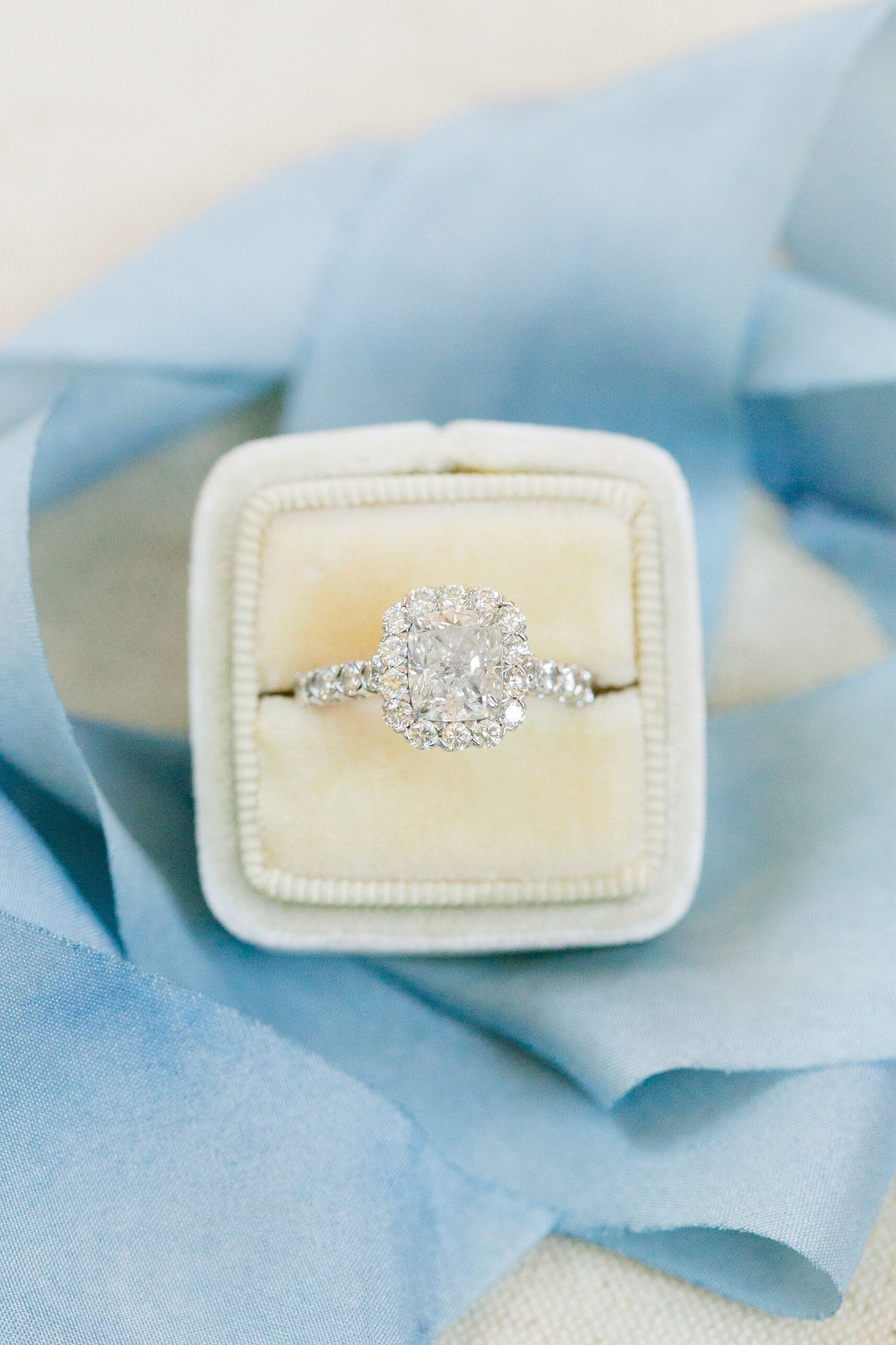 Cushion-cut engagement ring in a halo setting | Photography: Dana ...
