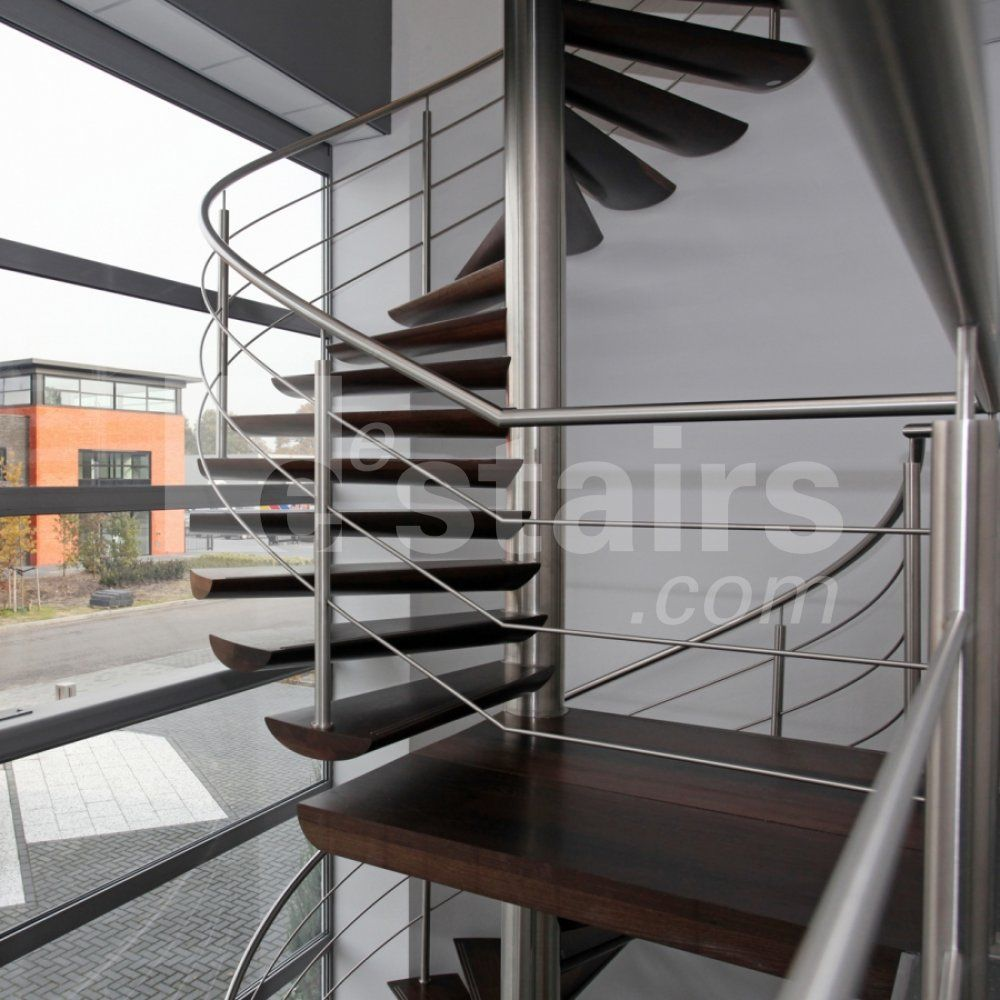 A Wooden Floating Spiral Staircase With A Stainless Steel Balustrade With  Railing And Intermediate Landing. Through The Glass Façade, The Parking  Spaces Are ...