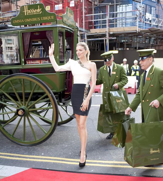 British model Lily Donaldson officially opened the doors to the iconic Knightsbridge store's summer sale this morning.