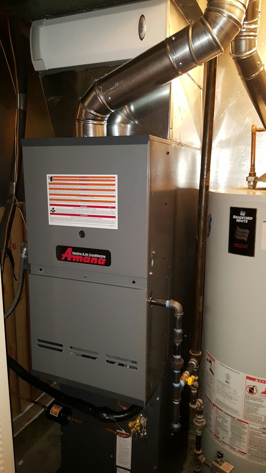 amana 2 stage variable speed downflow 80 non condensing furnace w an aprilaire media air cleaner installed by compass heating and air conditioning  [ 918 x 1632 Pixel ]