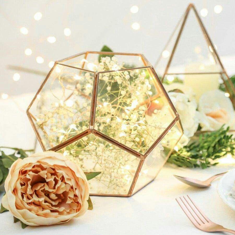 Geometric glass terrarium centerpiece with fairy lights