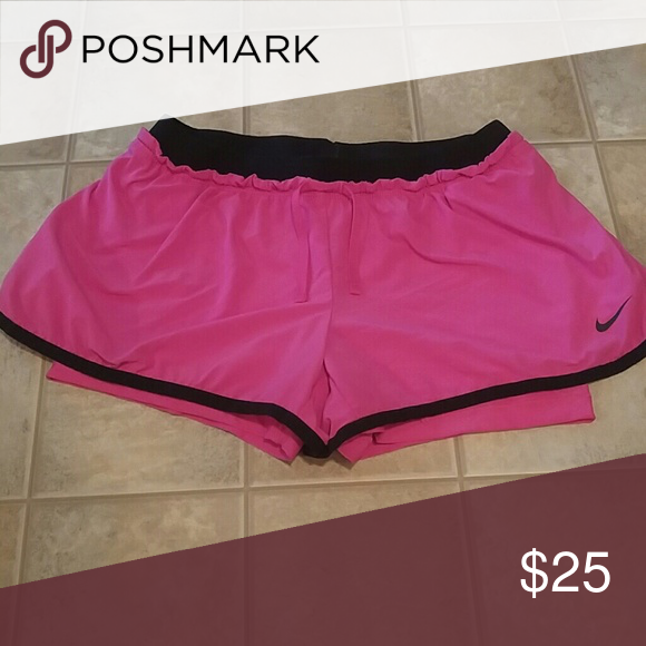 Pink Nike shorts Brand new Nike shorts! Attached spandex