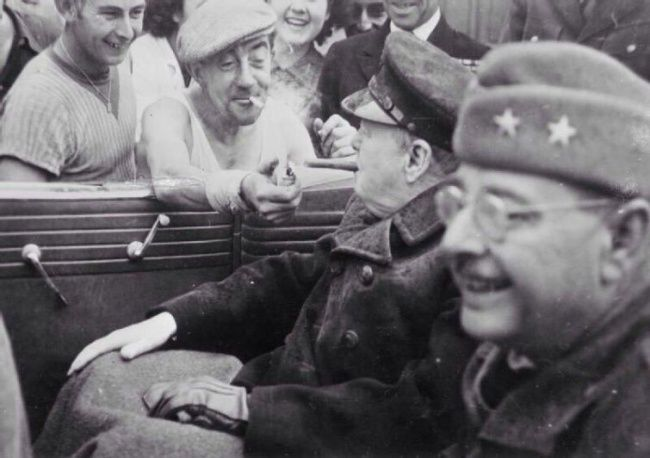 Winston Churchill leaving a singe cigar from the French