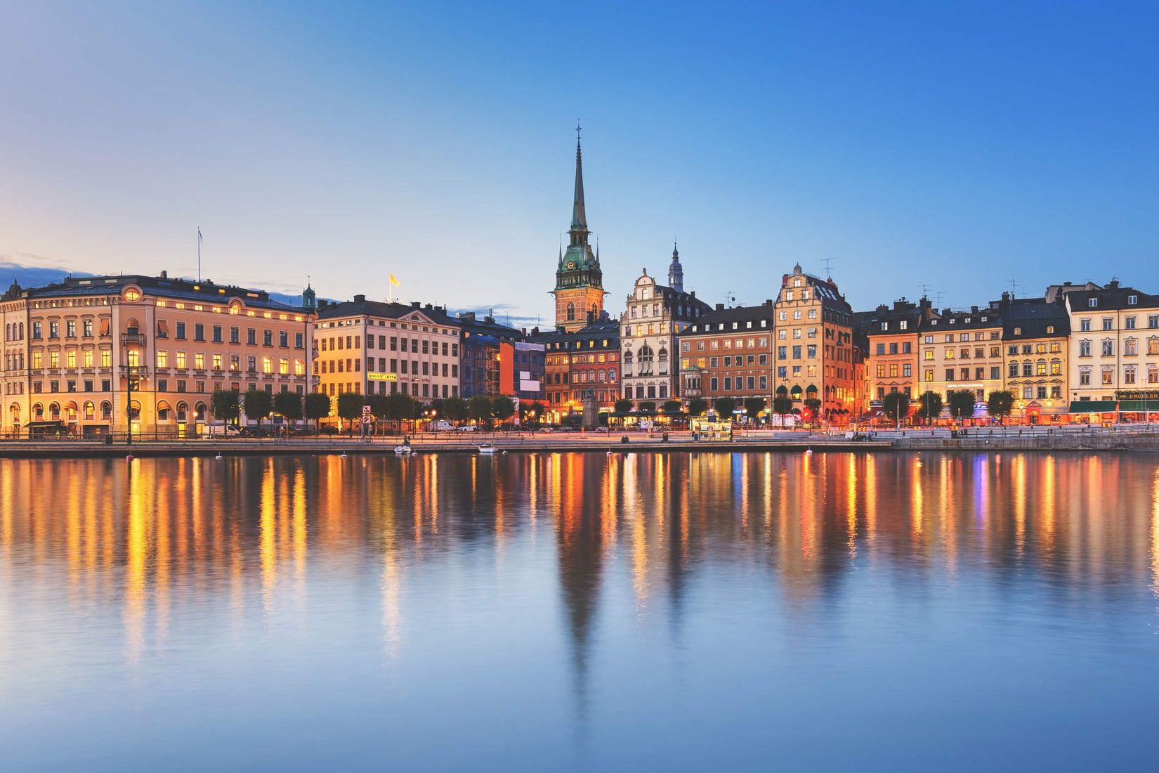 Transport yourself to the beautiful heart of Sweden with this Stockholm City Wallpaper Mural. This mural depicts a stunning dusk image of the capital city in all its glory as its warm lights reflect delicately on the clear water. This wallpaper mural is a perfectly gorgeous feature piece, and would belook right at home in...  Read more »
