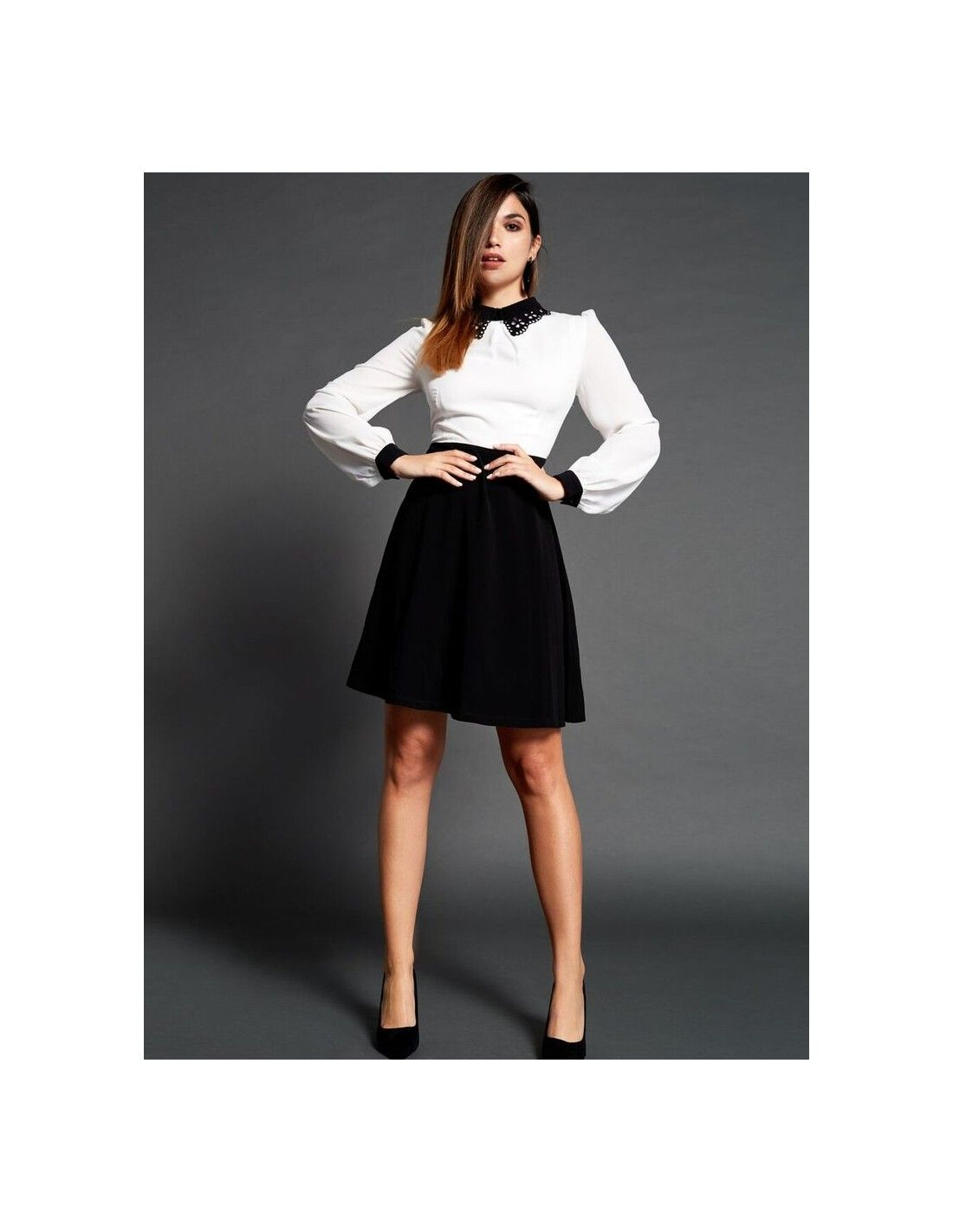 Vestido Malabo - Vestido bicolor en blanco y negro. Detalle de cuello en  negro troquelado 3941dbc4269e