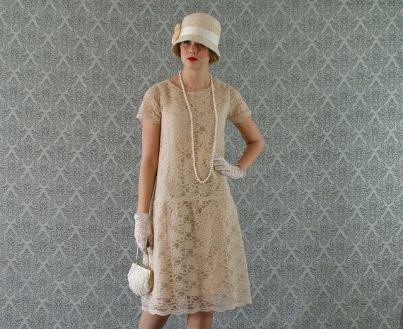 Elegant cream lace flapper dress with short sleeves great for Roaring 20s wedding dress