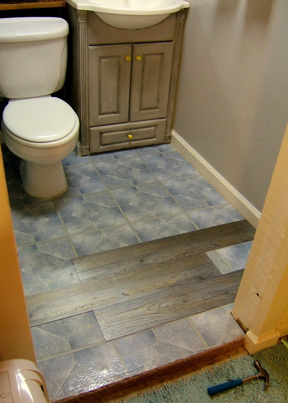 Interior Installing Floating Vinyl Plank Flooring Over Ceramic Wall Tiles For Small And Narrow Bathroom Spaces With Old Vintage Oak Wood Vanity Ideas