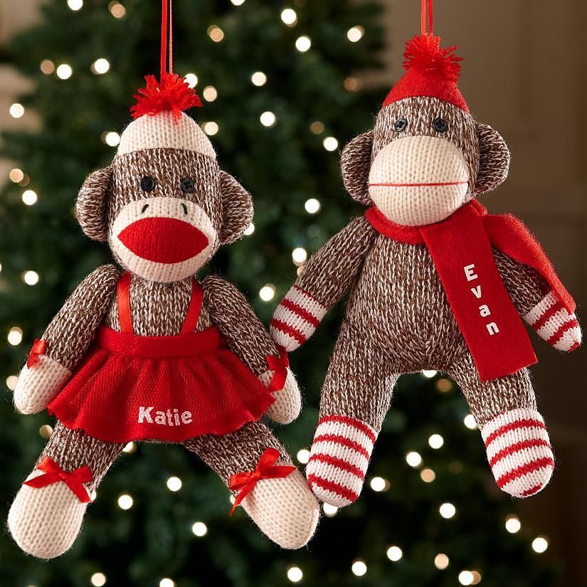 Sock Monkey Ornaments - A Personal Creations Exclusive! Delightful plush sock monkey ornaments add a whimsical touch to your tree. Choose from boy with scarf, girl wearing dress, or couple holding a heart. We personalize with any name, and any 2 names on the couple, up to 9 characters each.