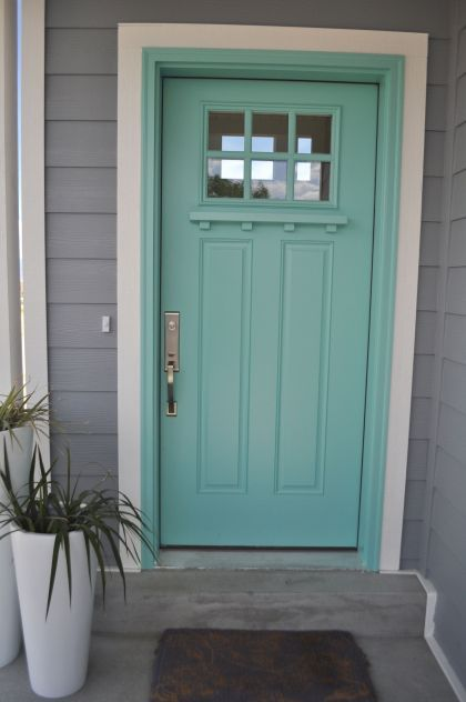 Turquoise Door White Trim And Grey Siding Shingle Siding