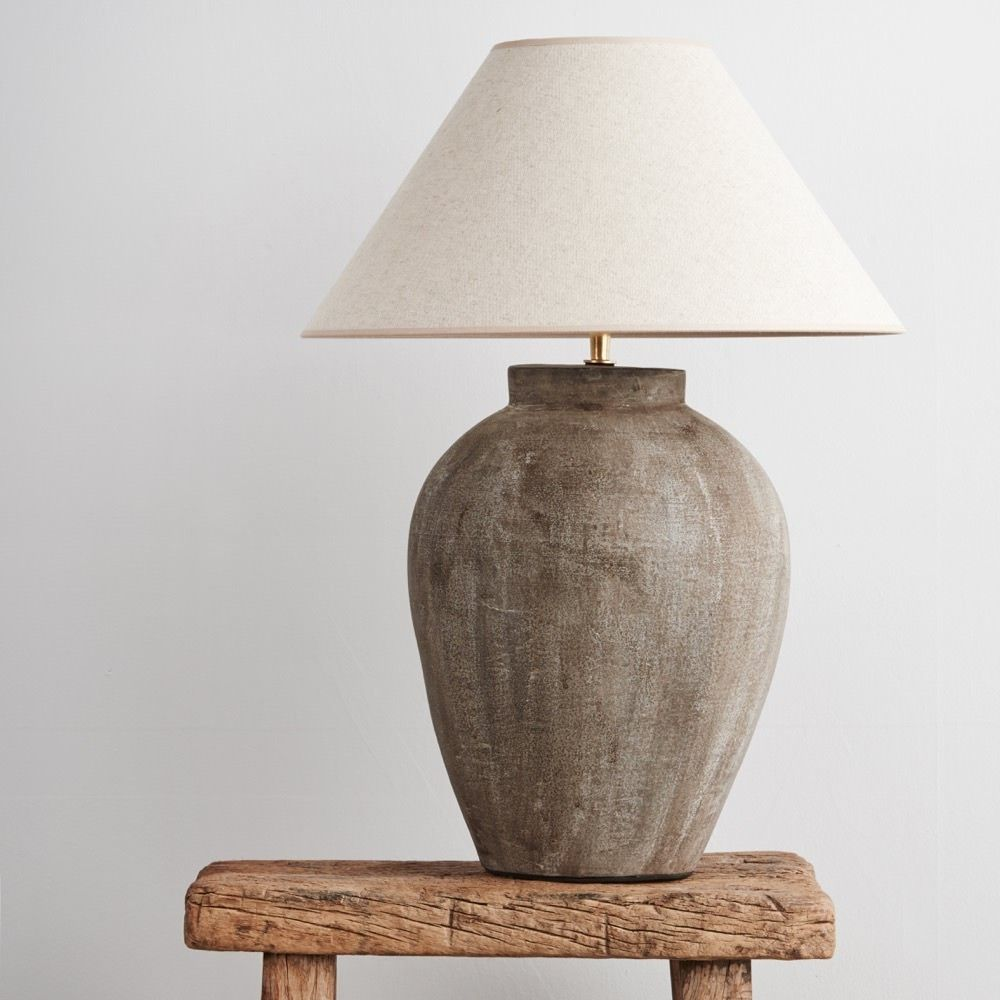 Table lamp with an ovoid ceramic base and natural linen empire ...