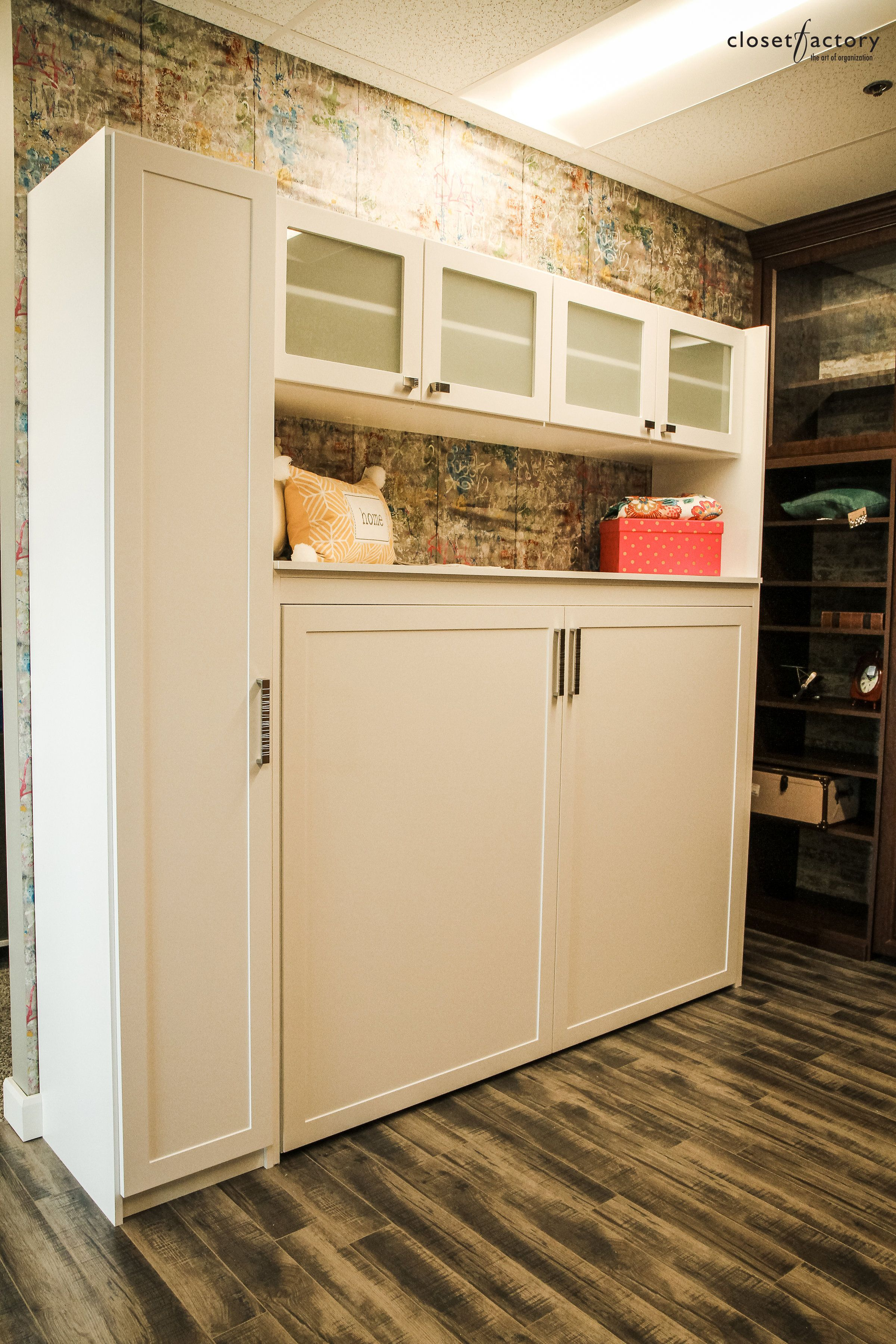 This Wall Unit In White Melamine Has Frosted Glass Cabinet Doors And One  Long Vertical Cabinet