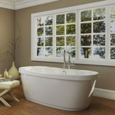 white freestanding bathtub in a bathroom with a large
