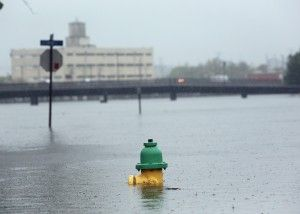 Flood waters come up out of the Hague during a nor'easter on Wednesday, Oct. 9, 2013.   (Steve Earley | The Virgi...