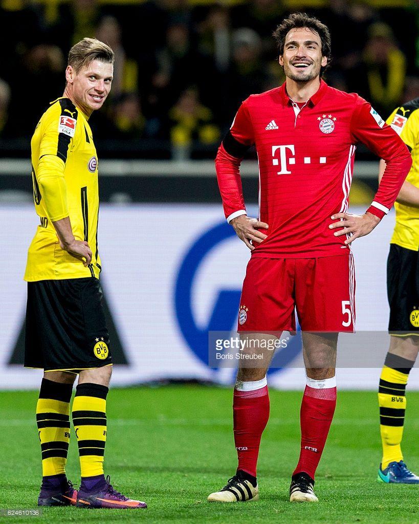 Lukasz Piszczek of Borussia Dortmund and Mats Hummels of FC Bayern