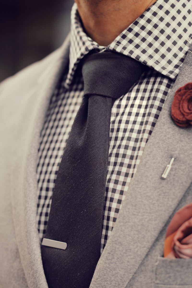 Grey suit gingham shirt red lapel flower black tie multi pocket