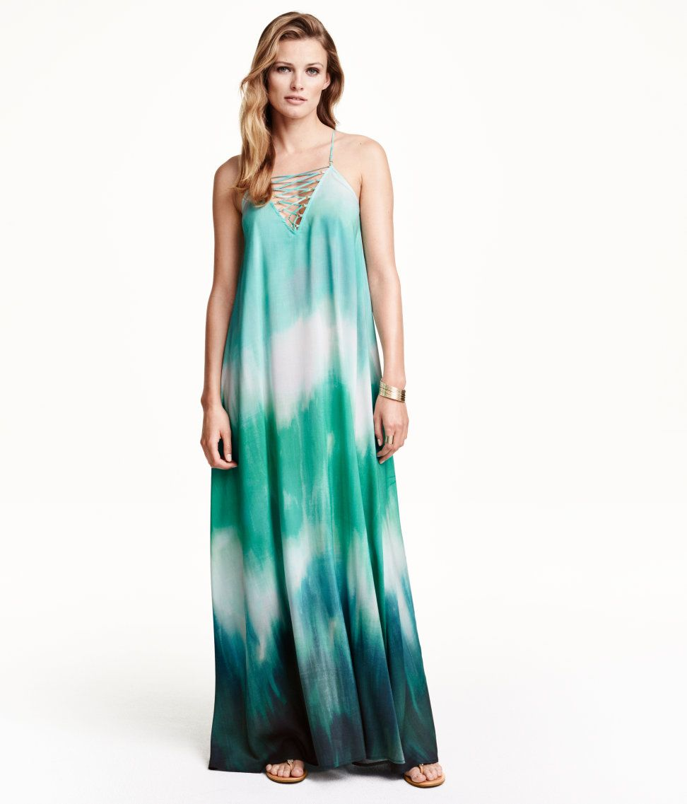 Be a Bohemian beauty in this flared maxi dress with decorative ...