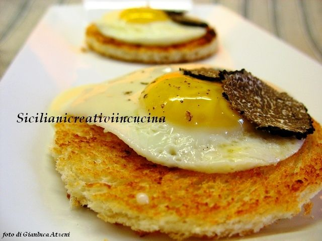 Photo of Quail eggs with black truffle and taleggio fondue