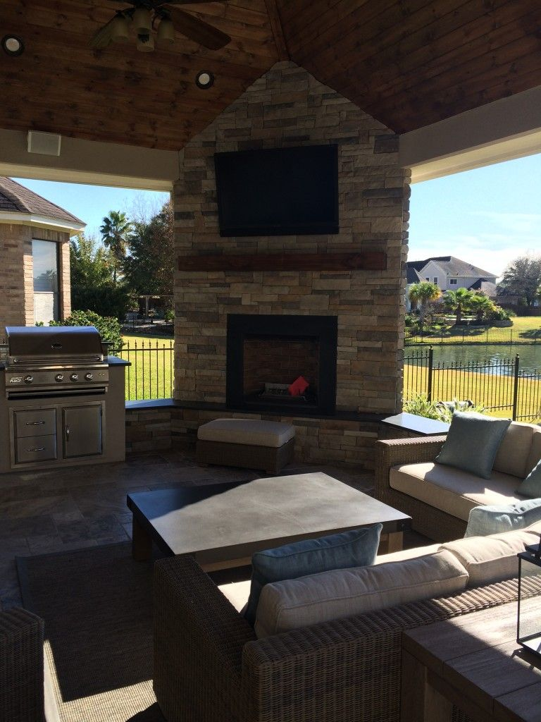 This Houston Patio Addition By Outdoor Homescapes Of Houston Features A Corner  Fireplace, An Outdoor