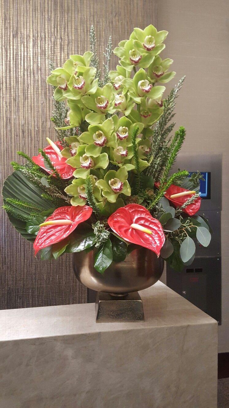 Display Arrangement Of Green Cymbidium Orchids And Red Anthurium Orchid Flower Arrangements Orchid Arrangements Flower Arrangements