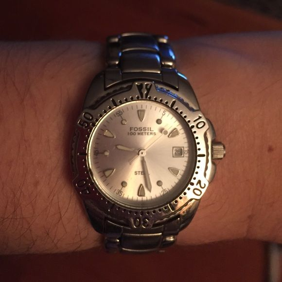 Silver Fossil watch Needs a new battery. No extra links come with it. Gently worn. Fossil Jewelry Bracelets