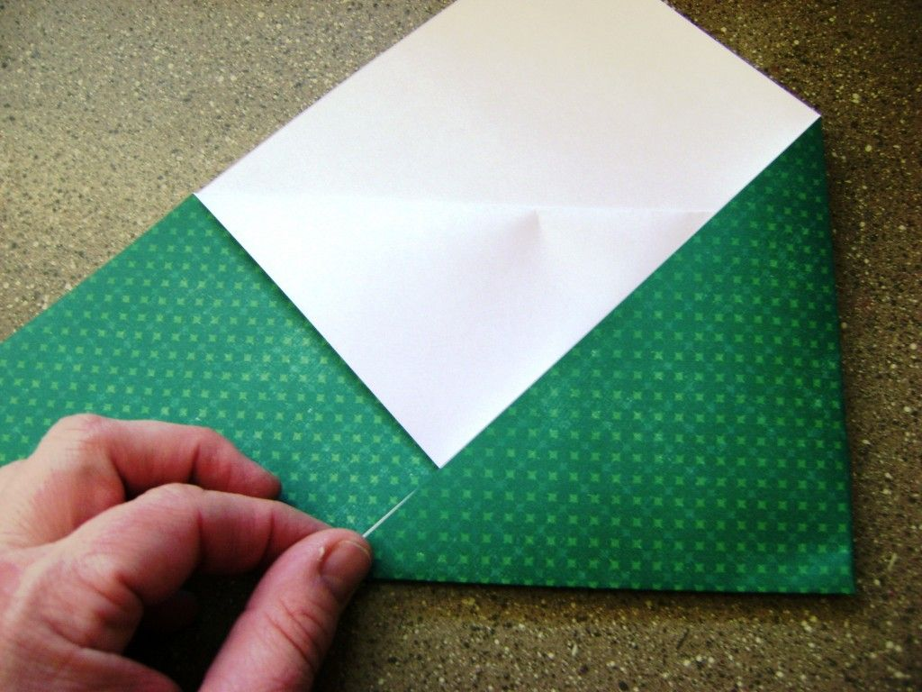 Folding envelope - step2: fold side in to 1/3, fold other side in to 1/3, should end up with a square-ish looking envelope