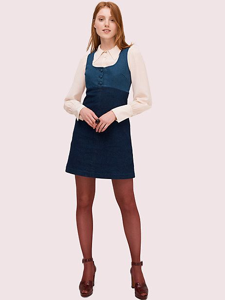 an a-line pinafore dress in a colorblock of blue and navy stretch-cotton denim with classic details like a button placket, scoopneck and side seam pockets. we sent it down our fall 2019 runway over a silky point-collar blouse and tights, but it can be layered over just about anything from tees to sweaters. | Kate Spade Denim Pinafore Dress, Indigo Multi - 8