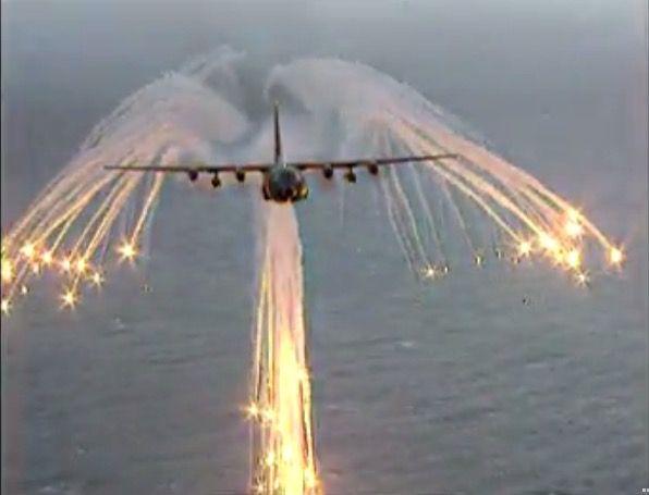 ac 130 gunship firing decoy flares confusing heat seeking missels