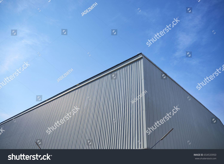 Metal Sheet Building With Vivid Sky Sponsored Affiliate Sheet Metal Building Sky Modern Graphic Design Building Stock Photos