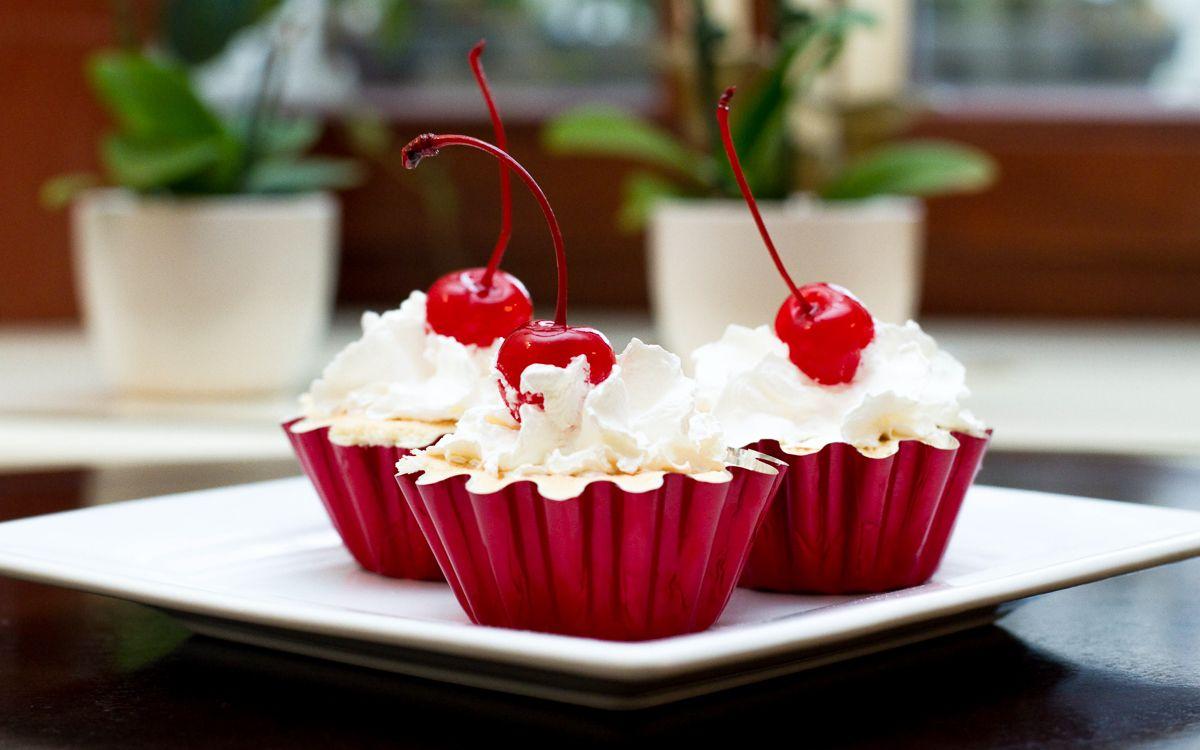 Vanilla Cupcakes with cream and cherry
