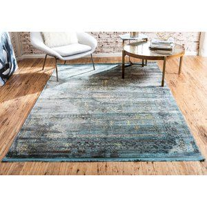 Ready to stand up to high foot traffic in the entryway and occasional spills under the kitchen table, polypropylene rugs are perfect for any area of your abode. Take this one for example: made in Turkey, it is machine-woven of polypropylene with a low pile height and features latex backing. Plus, it adds artful appeal underfoot as well with a tra