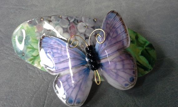 My friend makes 3-D Butterfly Barrettes created on a base made of upcycled materials.