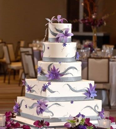 A Silver And White Wedding Cake With Lavender Sugar Flowers By Sweet Food Chicago